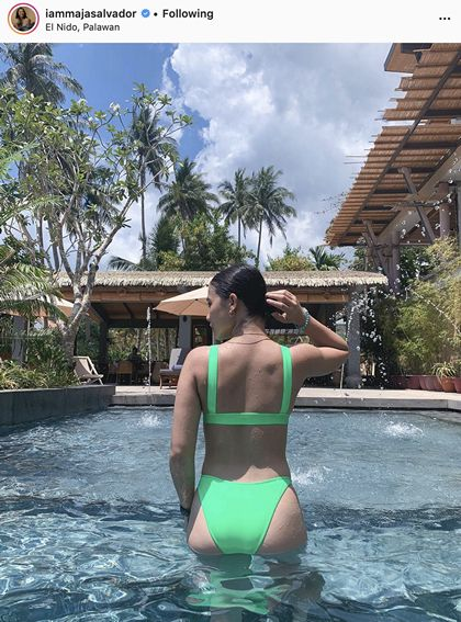 Maja Salvador in neon green two-piece swimsuit